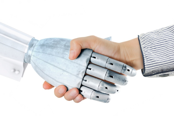 woman handshake with robot hand